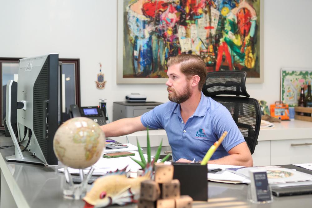 JV at his desk