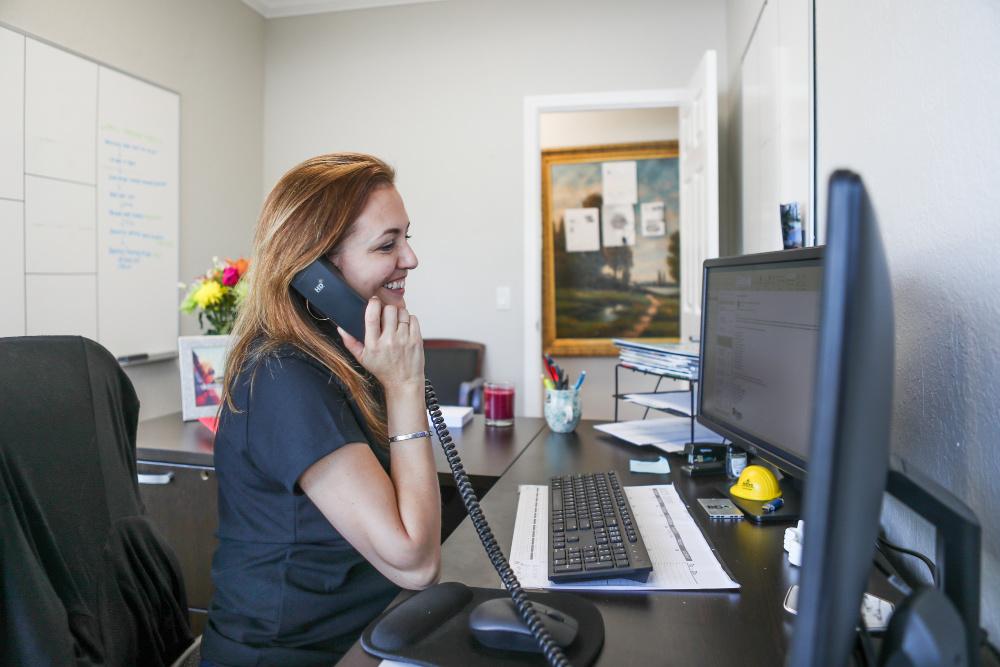 Dana at her desk